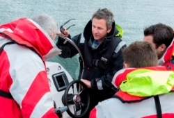 powerboat level 1 course - instructor talking to customers in a powerboat