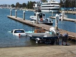 rya powerboat training - van parked in the water submerged trying to launch a powerboat