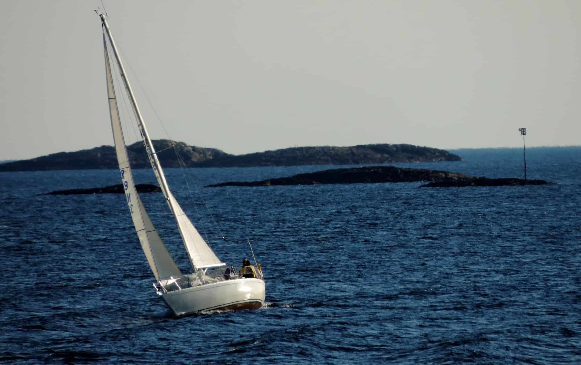 start sailing - yacht sailing with small islands in the background